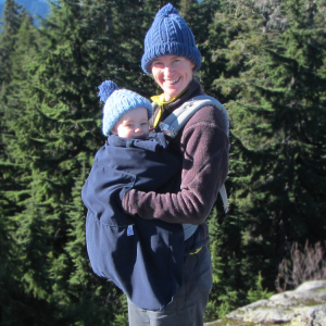 3-season baby carrier cover on a mountain